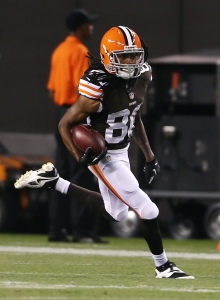 Aug 8, 2013; Cleveland, OH, USA; Cleveland Browns wide receiver Travis Benjamin (80) scores on a 91 yard punt return against the St. Louis Rams during the second quarter at FirstEnergy Field. Mandatory Credit: Ron Schwane-USA TODAY Sports
