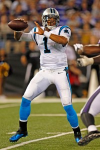 Aug 22, 2013; Baltimore, MD, USA; Carolina Panthers quarterback Cam Newton (1) drops back to pass against the Baltimore Ravens defense at M&T Bank Stadium. Mandatory Credit: Mitch Stringer-USA TODAY Sports