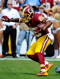 Sep 22, 2013; Landover, MD, USA; Washington Redskins running back Chris Thompson (25) returns a kick during the first half against the Detriot Lions at FedEX Field. Mandatory Credit: Brad Mills-USA TODAY Sports