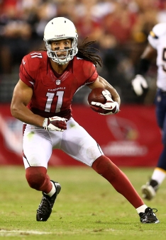 Aug. 24, 2013; Glendale, AZ, USA: Arizona Cardinals wide receiver Larry Fitzgerald (11) runs the ball in the second quarter against the San Diego Chargers during a preseason game at University of Phoenix Stadium. Mandatory Credit: Mark J. Rebilas-USA TODAY Sports